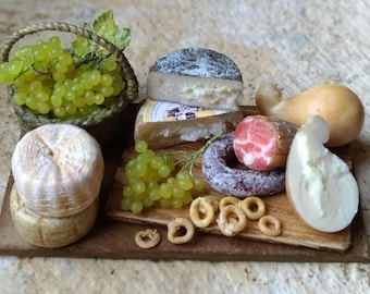 Rustic platter with salami, cheese, grapes