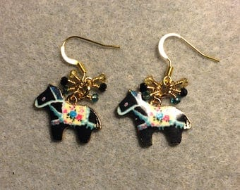 Black and turquoise enamel Scandinavian horse charm earrings adorned with tiny dangling black, turquoise, and yellow Chinese crystal beads.