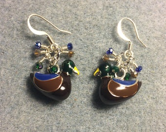Brown, green, and dark blue enamel duck charm earrings adorned with tiny dangling brown, green, and dark blue Chinese crystal beads.