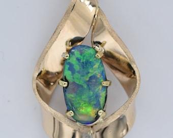 7mm x 14mm Stunning Australian Crystal opal pendant in 18k yellow gold.