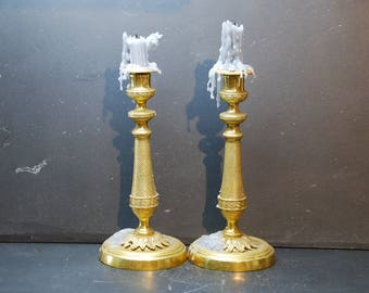 Two French antique gilded bronze candlesticks circa 1850, Style Empire,  with embossed pineapple style .
