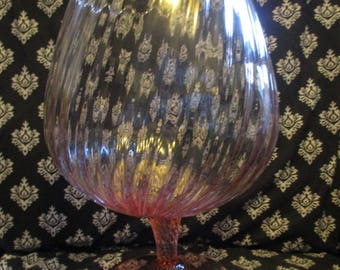 Pink ribbed glass bowl on pedestal
