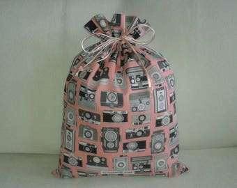 Cameras retro black on pink background on my pouch