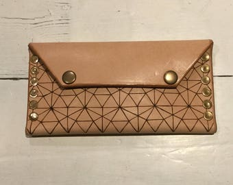 Handmade leather purse/wallet, decorated with a geometrical pyrographed pattern.