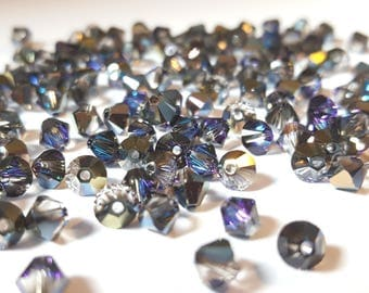 Pack of 100 Genuine Swarovski Elements 5328 Xilion 4mm bicone bead in heliotrope [our ref: pb1069]