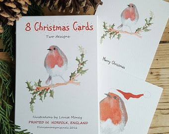 Robin Christmas cards. Two Robin designs featured in a pack of eight cards and envelopes. Robin cards. British bird card. Robin gift pack
