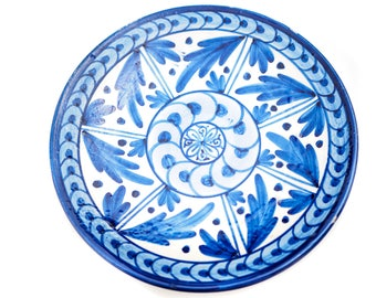 Folksy, stoneware pottery plate with blue and white paint - European