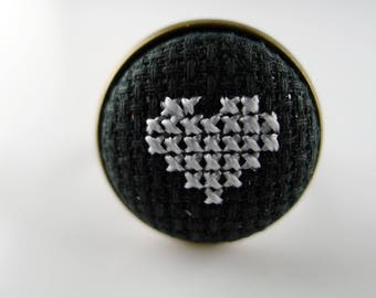 Cross-stitched heart ring