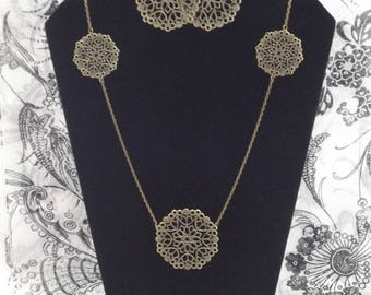 Bronze long necklace with three stamps and a pair of earrings