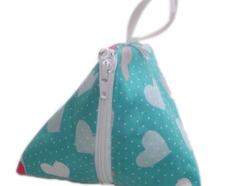 Put your pacifier pouch, turquoise hearts.