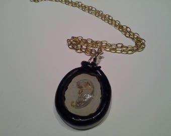 Mummified pinky mouse necklace