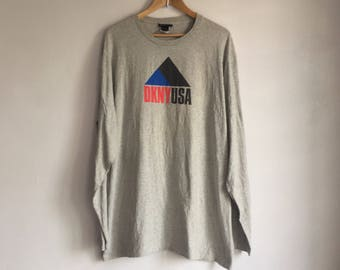 RARE!!!! Vintage Made In USA 90's DKNY Spellout Big Logo Long Sleeves T-Shirt in Perfect Condition Size L