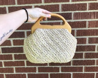 woven basket bag with wooden top handle
