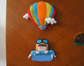 Hot air balloon with his child pilot for decoration