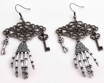 Steampunk earrings dangle skeleton hand print and key bronze and silver