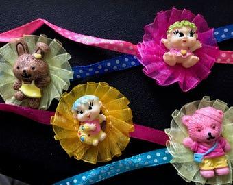 Cute cartoonish kids rakhi with baby, bear, or bunny