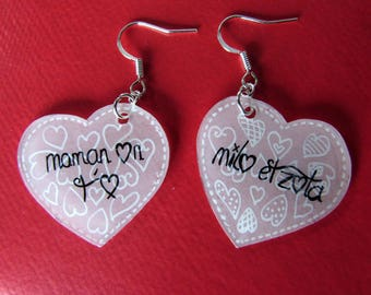 Customizable heart earrings.