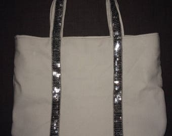 Tote bag has grey and black glitter