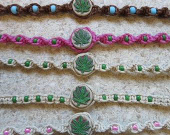 Pot leaf Hemp bracelet, hand painted ceramic bead with glass accent beads. Hand tied in Bremerton, WA
