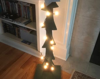 Wooden lit Christmas tree