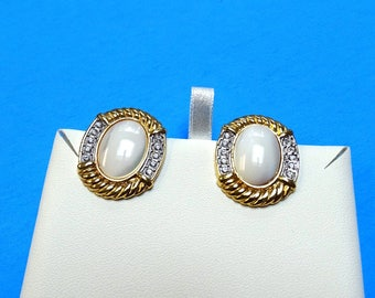 Butler earrings with large  oval cabochons surrounded by clear white rhinestones Clip back earrings marked pat pending