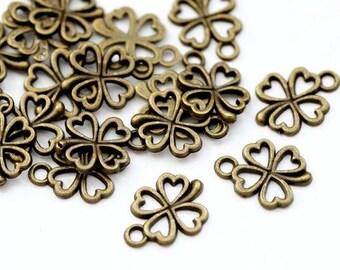 10 St. Metal pendant clover, bronze colour, 14 x 13 mm