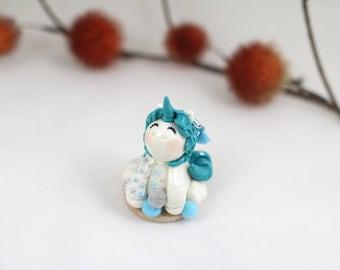 Unicorn Piercee and tattooed cold porcelain