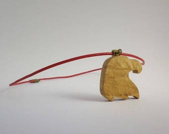 Eagle in oak and red leather pendant