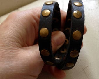Double twist adjustable black leather studded bracelet