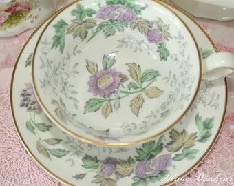 Wedgwood, England: Tea cup & saucer with mauve flowers