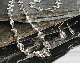 Silver Spiral Jewellery Set, necklace, bracelet, earrings, jewellery