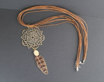 Rosette and feather necklace