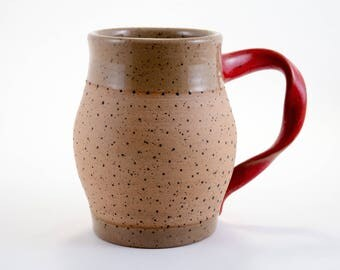 Large mug, speckled, stylish red handle, texture