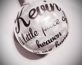80mm Personalised a little piece of heaven in our home bauble containing white feather and gems can be added