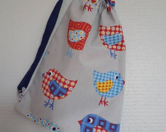 Bag in blanket patterned colorful chicks on a grey background