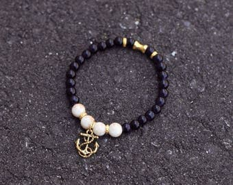 Bracelet with glass beads and gold tone anchor
