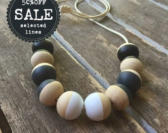 black, grey and white hand painted wooden bead necklace