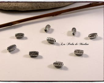Set of 4 - 7x4mm - ref:z307 silver patterned Metal beads