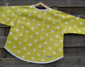 Little school lime waxed canvas apron has dots