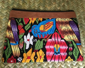 Eco friendly up cycle clutch from a Guatemalan huipil handmade