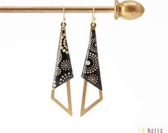 Earrings are made of resin pattern circles and black polka dots