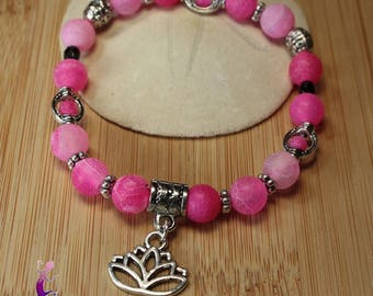 Frosted look pink agate bracelet with silver metal lotus flower charm