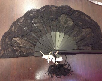 Refined black French lace and wood fan