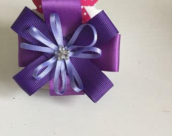 Purple circular hair bow