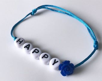 HAPPY bracelet white pearls and blue flower