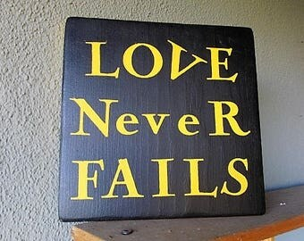 """Custom Sign Says, """"Love Never Fails""""    Yellow on Chalk Black Paint, Beautiful inspirational wood sign , Great Gift!"""