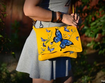 Yellow leather crossbody bag with painted butterflies for ladies. A unique shoulder purse, lined on the inside with detachable strap