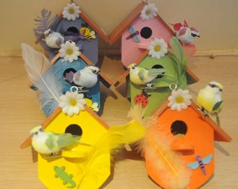 small birdhouse decorated with a bird inside