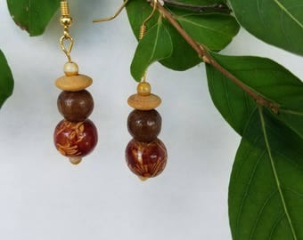 Wooden decorated brown beaded earrings. Light weight , gold tone.