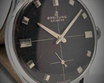 Breitling man's vintage swiss watch hand winding black dial.